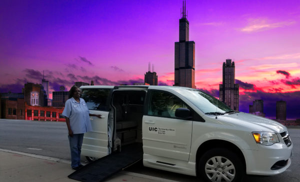 UIC Paratransit vehicle and driver